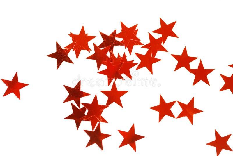 Décoration de vacances avec les étoiles rouges de Noël photographie stock libre de droits