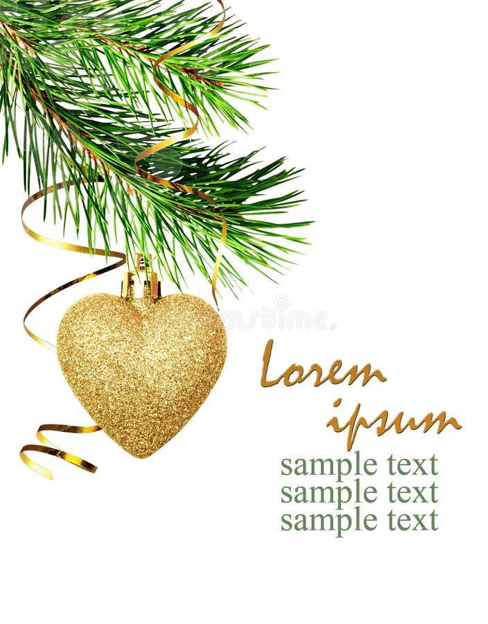 Décoration faisante le coin de Noël avec les brindilles de pin et le coeur d'or images libres de droits