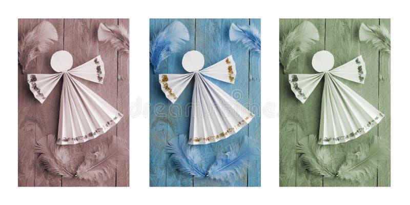 Décorations faites main de Noël, ange de papier sur le fond en bois triptyque images stock