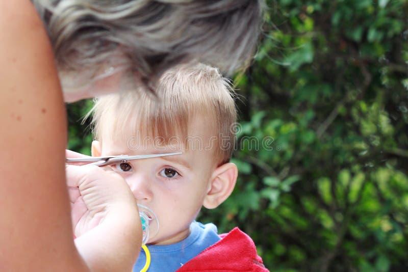 Découpage premier de cheveu photos stock