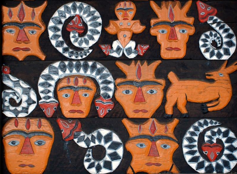 Découpages du bois peints indigènes photo libre de droits