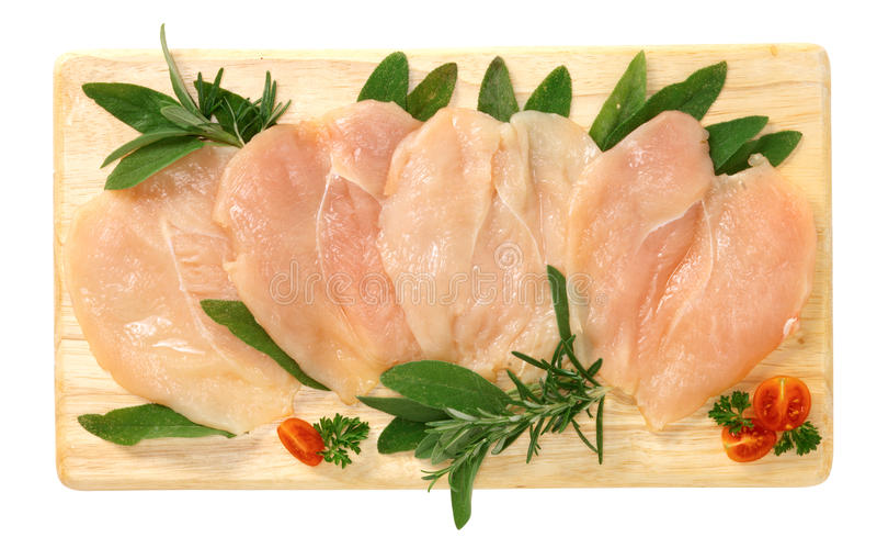 Découpe le poulet en tranches image libre de droits