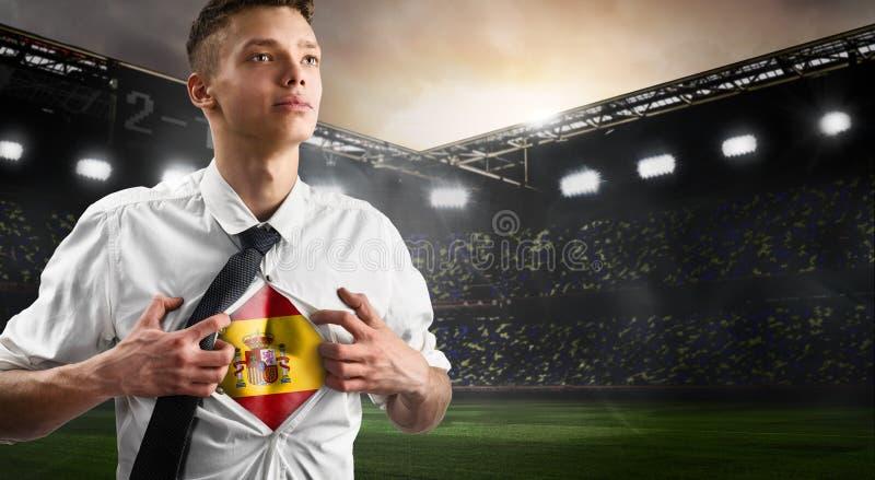 Défenseur du football ou du football de l'Espagne montrant le drapeau image libre de droits