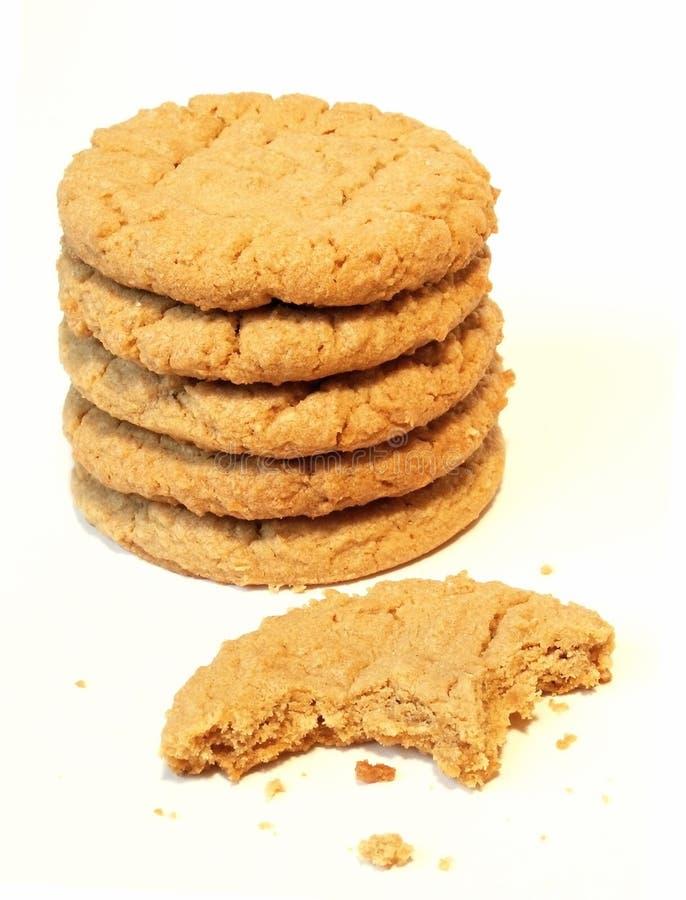 Dégustation d'un biscuit de la pile photographie stock libre de droits