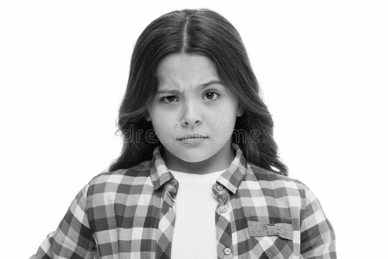 Déjeme pensar Sospechoso dudoso de la cara de la muchacha su El niño tiene dudas La cara pensativa del equipo casual de la muchac imagen de archivo