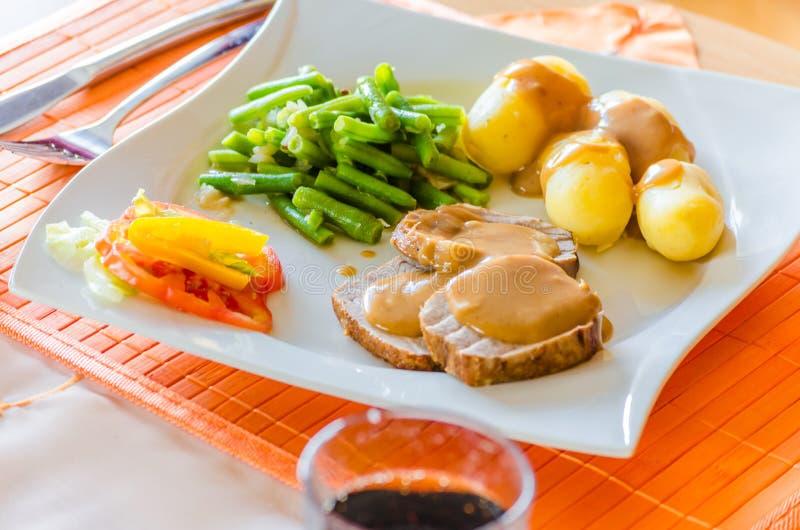 Déjeuner, rôti de porc photos libres de droits