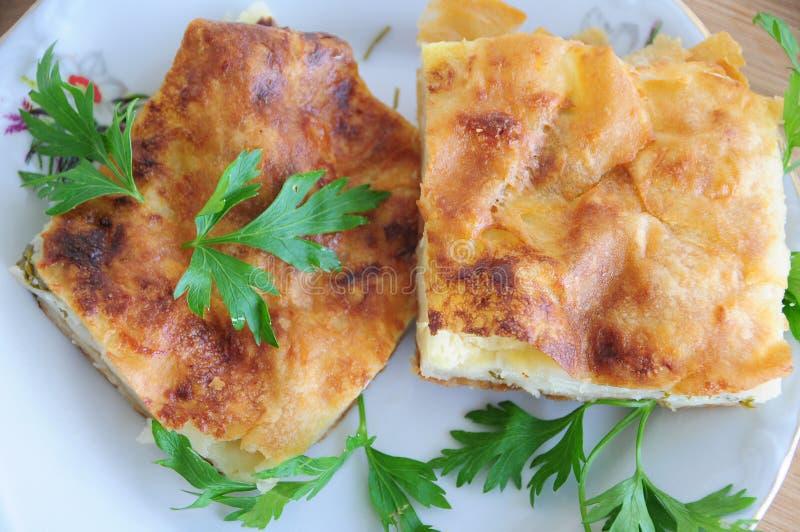 Délicieux et persil en tarte de fromage de plat photo libre de droits