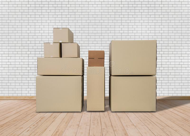 Déménager la maison neuve Pièce vide avec des boîtes de carton photos stock