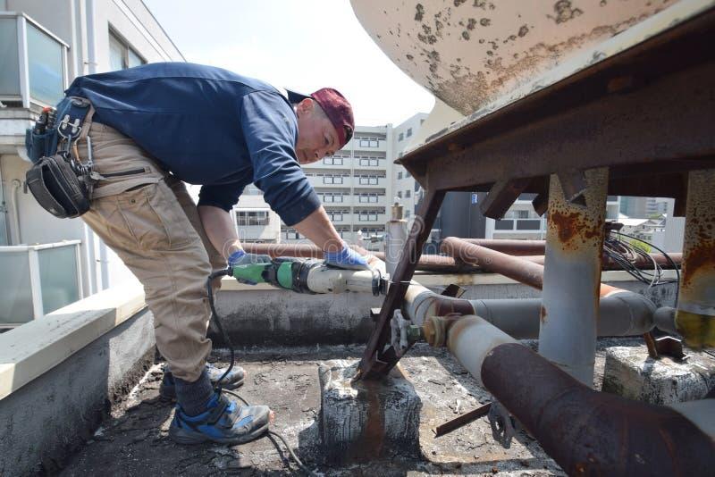 Démantelez la cuve de stockage de l'eau à Osaka photographie stock libre de droits
