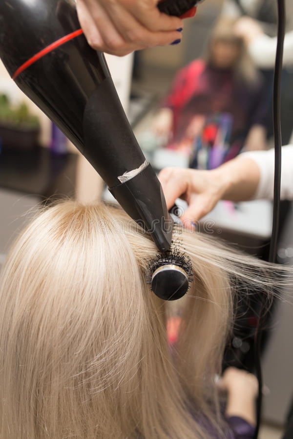 Dénommer le sèche-cheveux femelle images stock