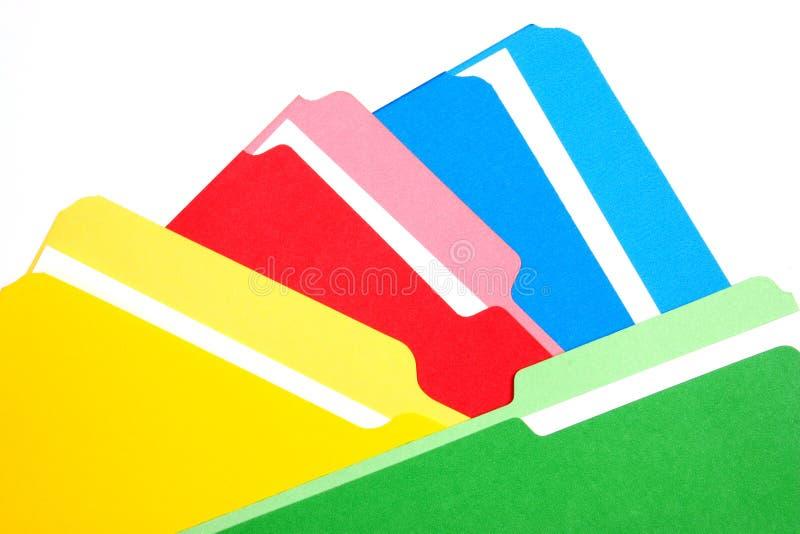 Dépliants colorés quatre couleurs empilées photographie stock