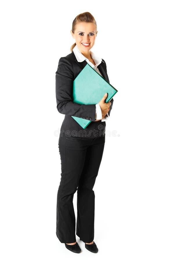 Dépliants de fixation de femme d'affaires avec des documents photo stock