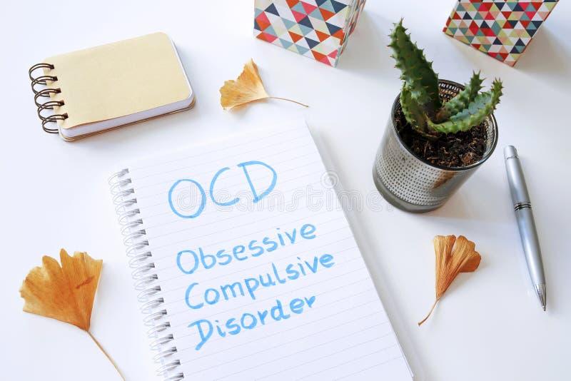 Désordre obsessionnel d'OCD écrit dans le carnet photos libres de droits
