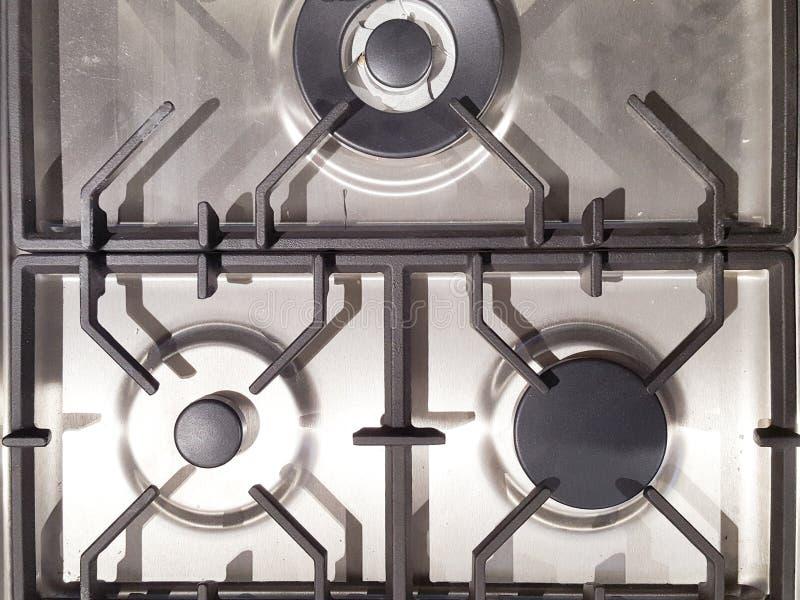 Détail brûlant de plan rapproché de fourneau de cuisine de brûleur à gaz photos stock