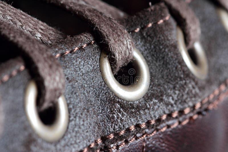 Détail d'oeillets et de lacets de chaussure photographie stock