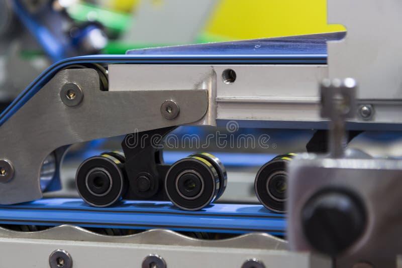 détail d'une machine de gluer de dossier photo libre de droits
