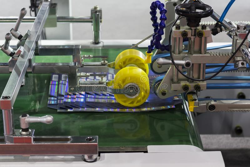 détail d'une machine de gluer de dossier photos libres de droits