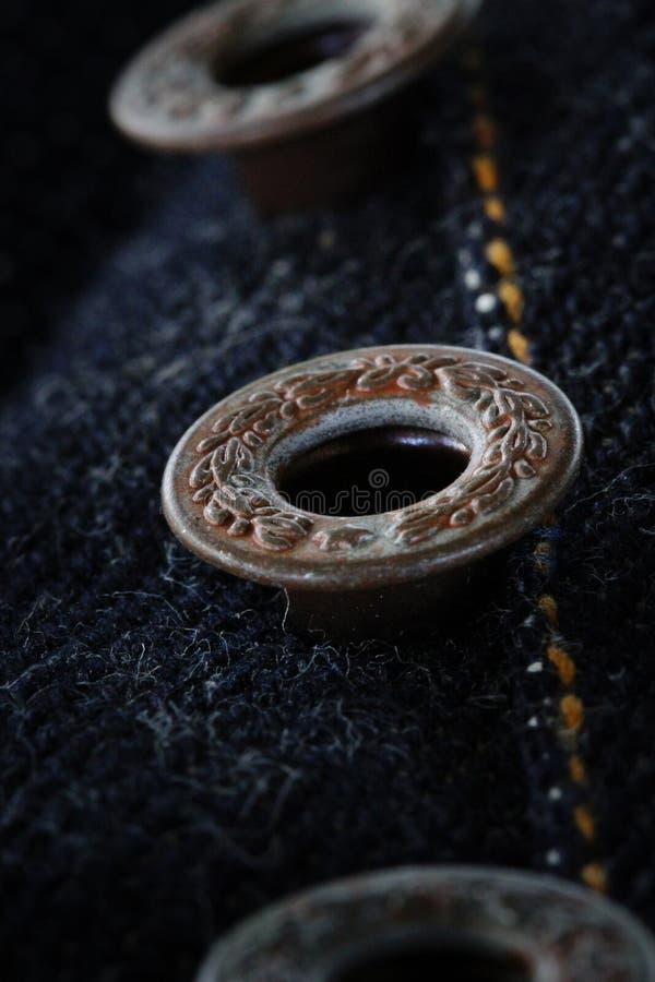 Détail de bouton de jeans image stock