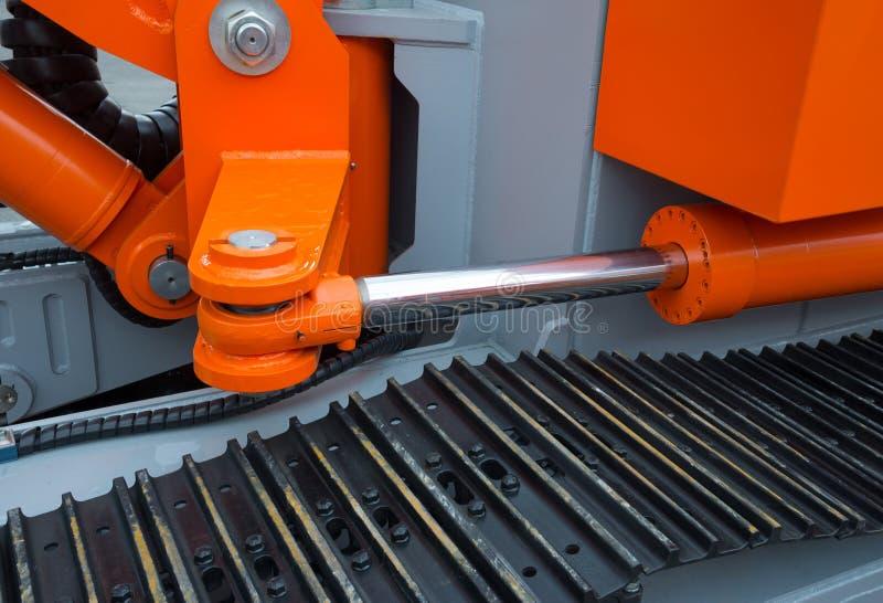 Détail de bras hydraulique d'excavatrice de piston de bouteur image stock