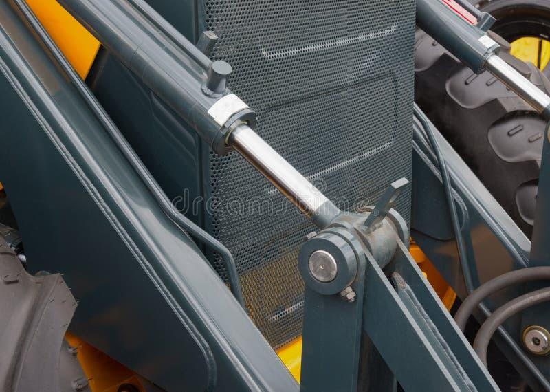 Détail de piston hydraulique de bouteur photos stock