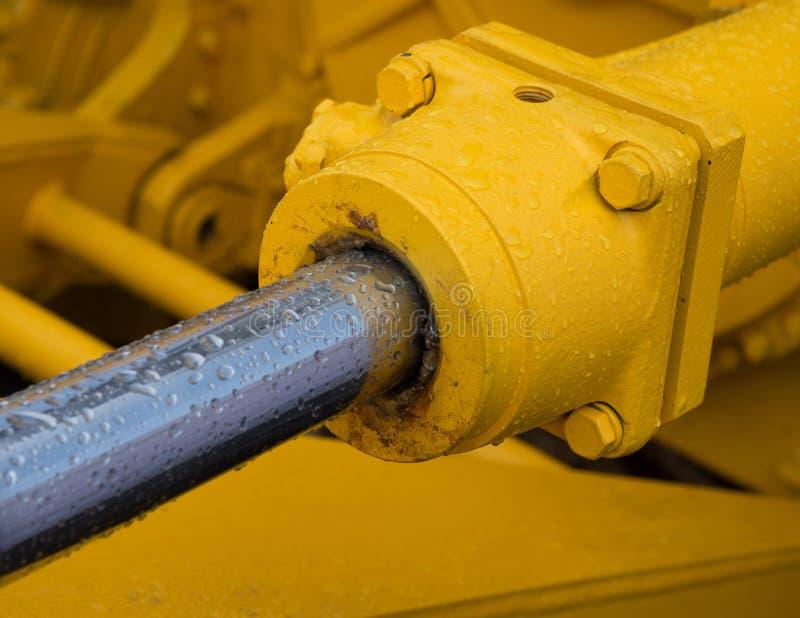 Détail de piston hydraulique de bouteur images libres de droits