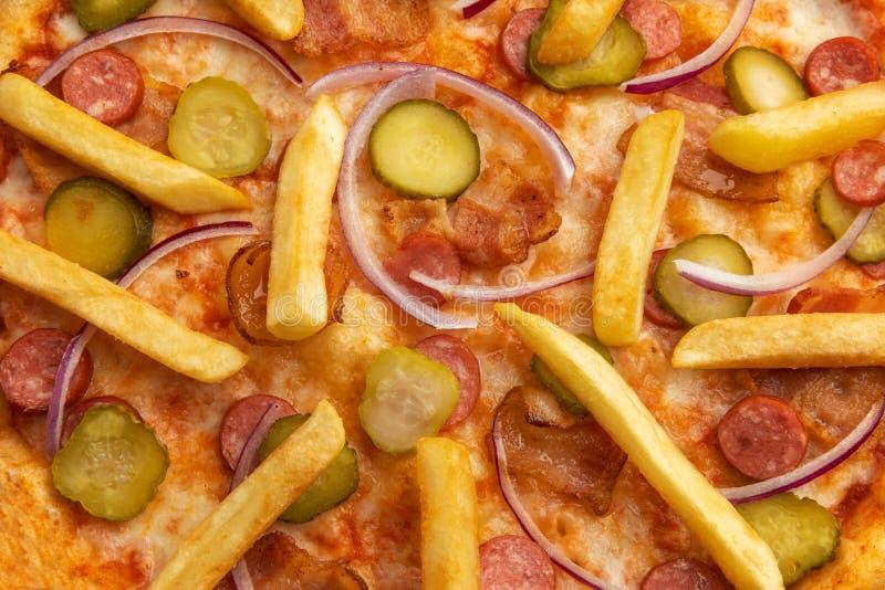 Détail de pizza avec le plan rapproché de pommes de terre photo libre de droits