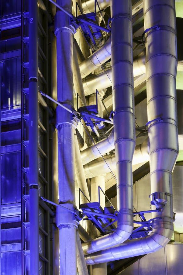 Détail du bâtiment de Lloyd's la nuit photos libres de droits
