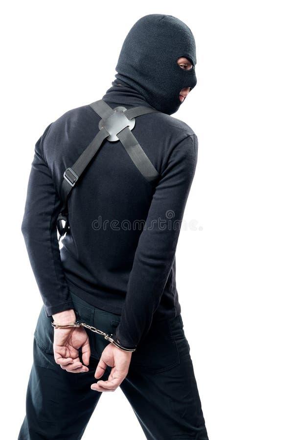 Détention d'un terroriste dangereux dans des vêtements noirs et un masque photos stock