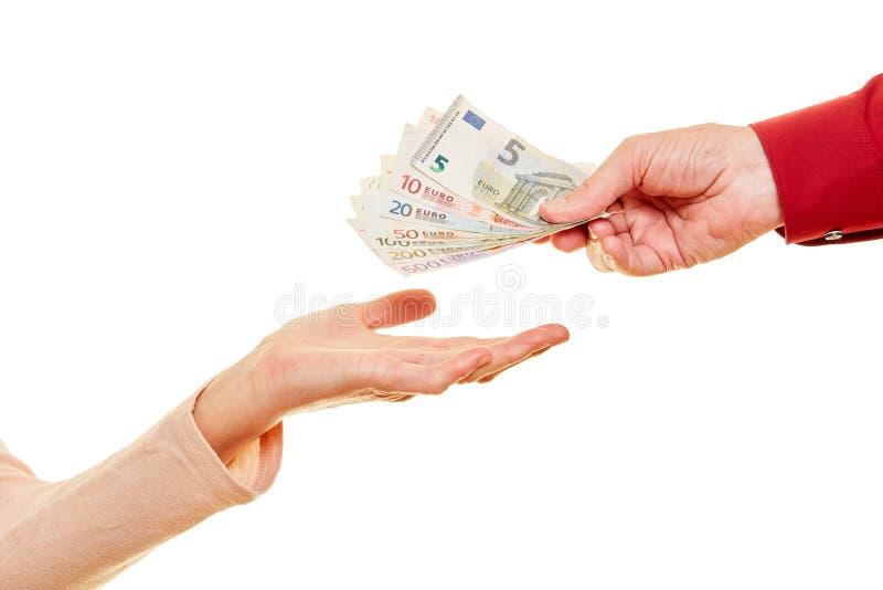 Dê o dinheiro ou doe-o como cédulas do Euro fotografia de stock