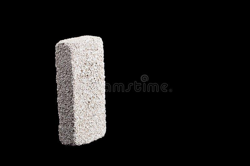 Dê polimento à pedra para os saltos de lavagem em um isolado preto do fundo imagem de stock royalty free