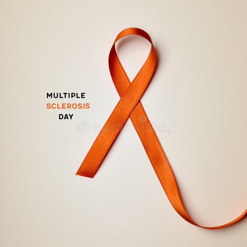 Día anaranjado de la esclerosis múltiple de la cinta y del texto fotos de archivo libres de regalías