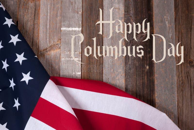 Día de Colón feliz Estados Unidos señalan por medio de una bandera imágenes de archivo libres de regalías