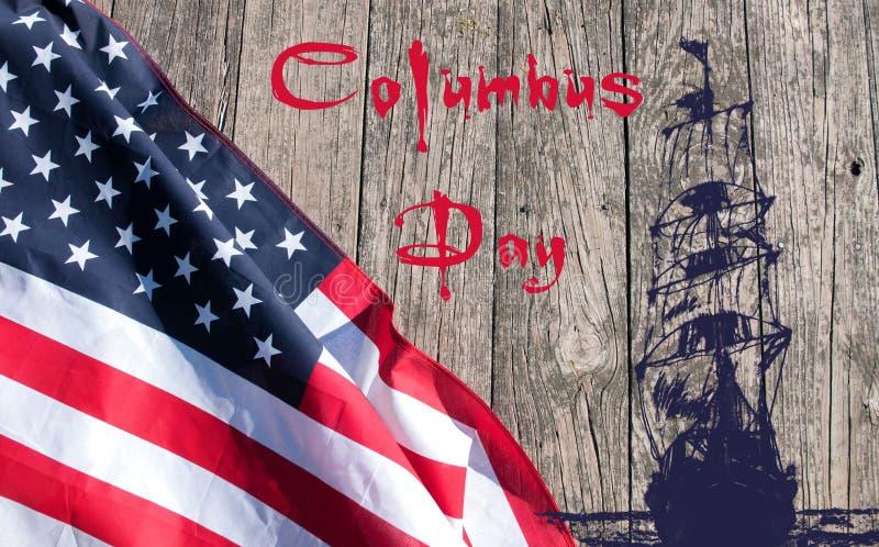 Día de Colón feliz Estados Unidos señalan por medio de una bandera imagenes de archivo