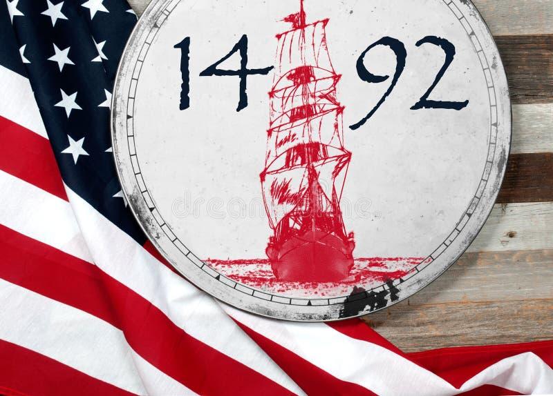 Día de Colón feliz Estados Unidos señalan por medio de una bandera fotografía de archivo