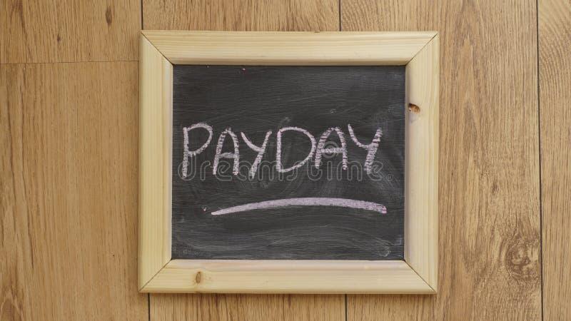 Día de paga escrito imágenes de archivo libres de regalías