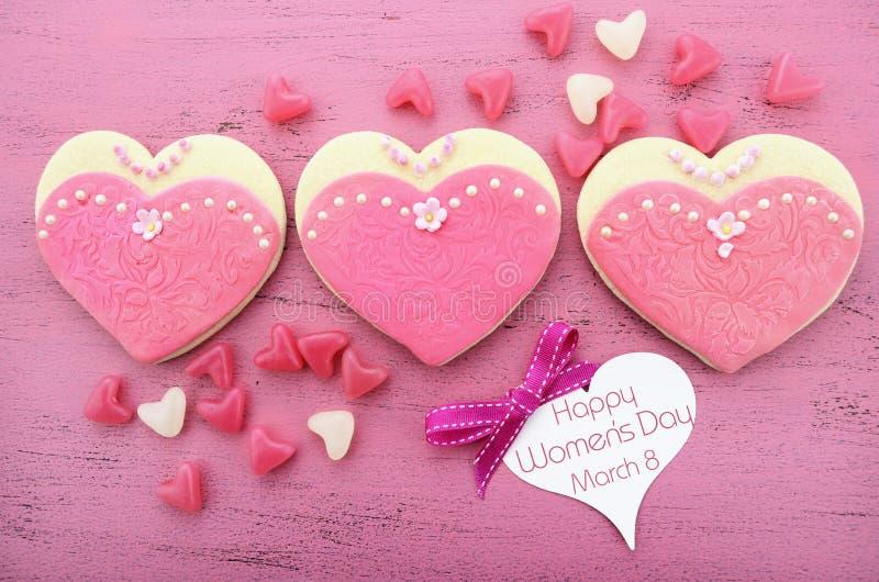 Día para mujer internacional, el 8 de marzo, galletas de la forma del corazón fotos de archivo
