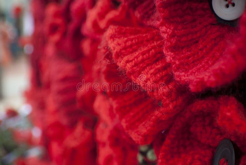 Día rojo hecho punto de la conmemoración del día del anzac de la amapola imagen de archivo