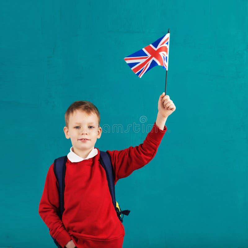 Días de fiesta de escuela Reino Unido Reino Unido Pequeño colegial con natio fotos de archivo libres de regalías