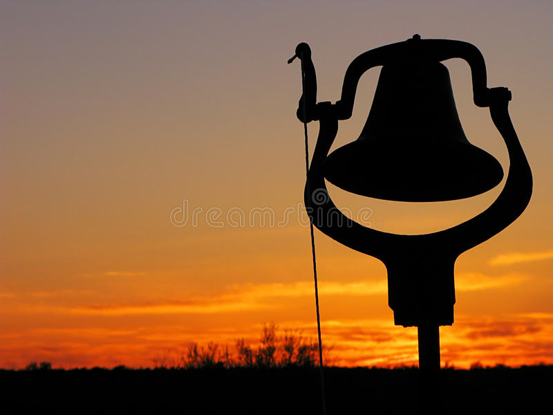 Dîner Bell silhouetté photo stock
