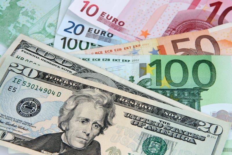 Dólar americano E euro- notas imagens de stock