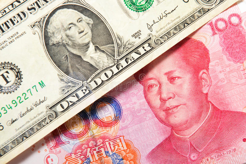 Dólar americano e yuan chinês imagem de stock