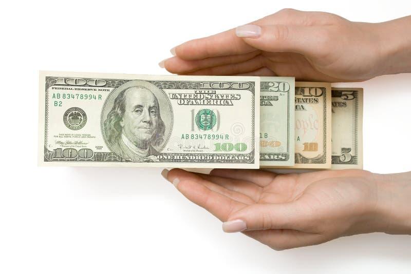Dólar americano en escala en la mano de la mujer, aislada foto de archivo libre de regalías
