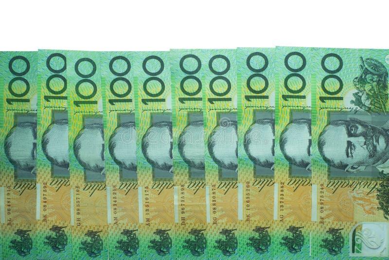 Dólar australiano, dinheiro de Austrália 100 dólares de pilha das cédulas no fundo branco com trajeto de grampeamento fotografia de stock