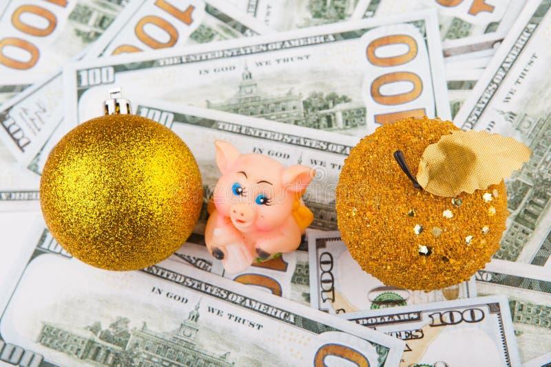Dólar del dinero del cerdo de la bola de la manzana del oro del juguete del Año Nuevo imágenes de archivo libres de regalías