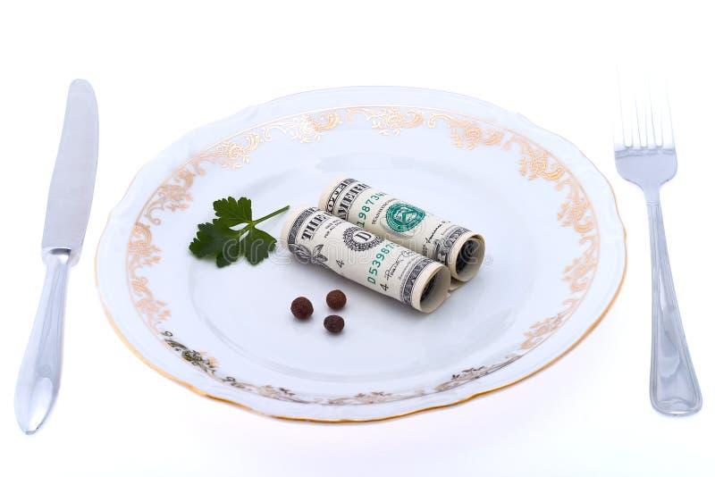 Dólar en la placa fotografía de archivo