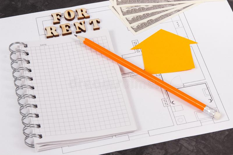 Dólar, libreta y diagramas eléctricos, casa de alquiler o concepto plano fotos de archivo libres de regalías