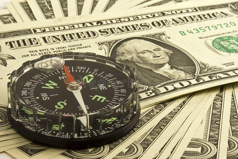 Dólar y compás foto de archivo libre de regalías