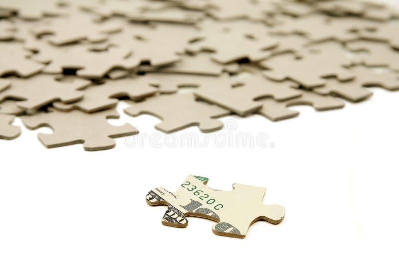 Dólar y rompecabezas fotografía de archivo
