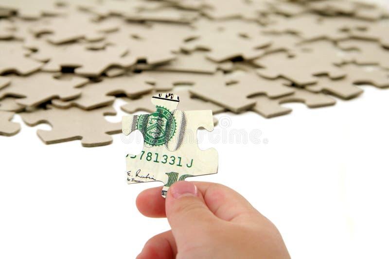 Dólar y rompecabezas foto de archivo