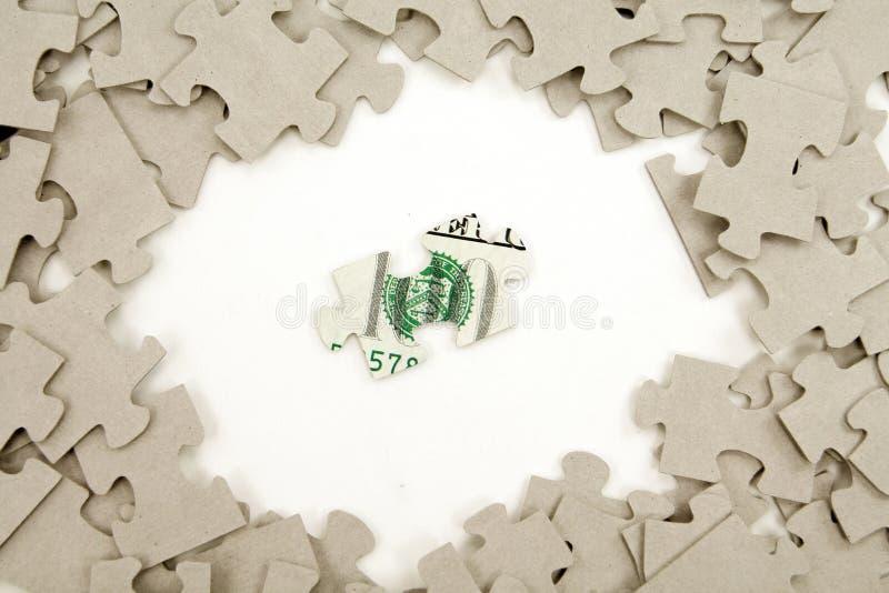 Dólar y rompecabezas fotos de archivo libres de regalías